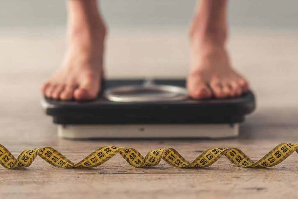 person on the weighing scale