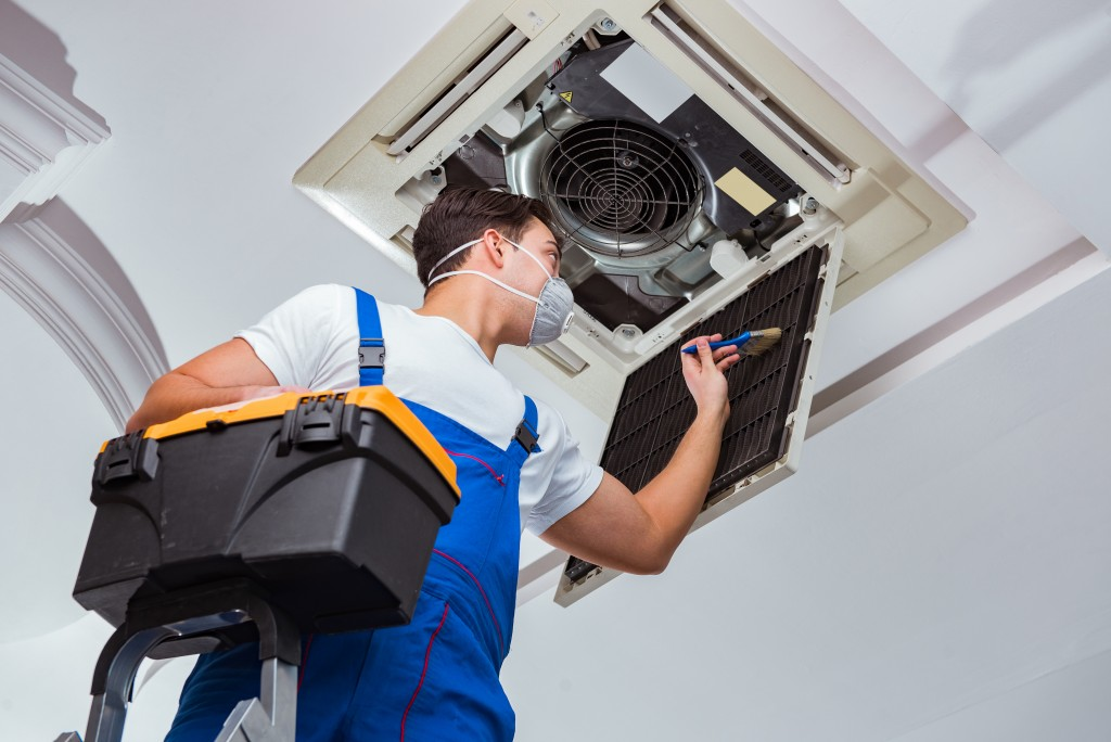contractor cleaning the aircon