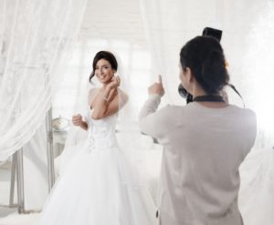 taking photos of the bride