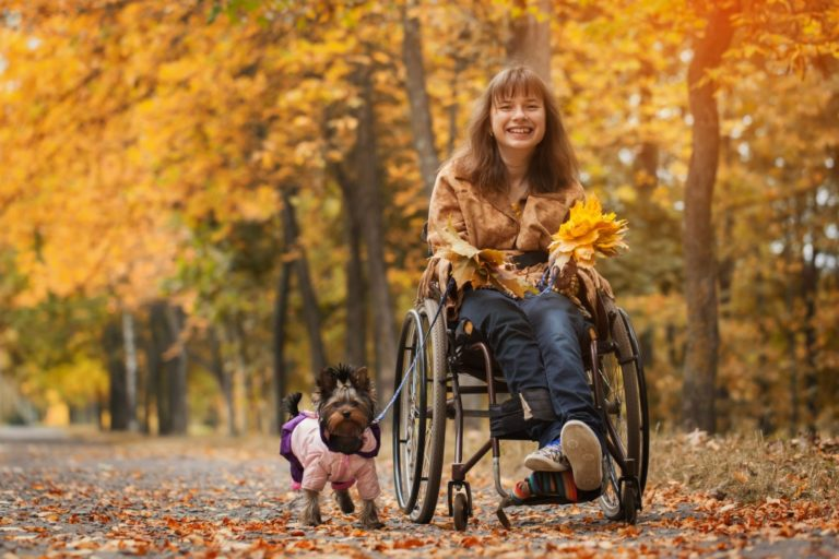 cheerful girl in wheelchair