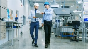 engineers in the manufacturing facility