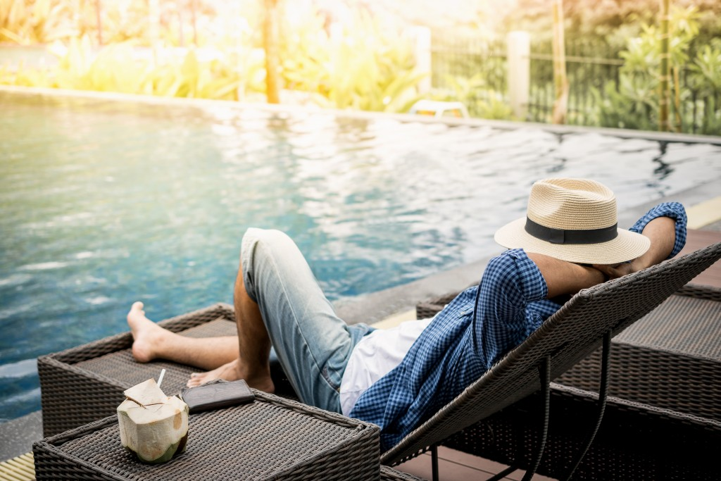 man chilling beside the pool