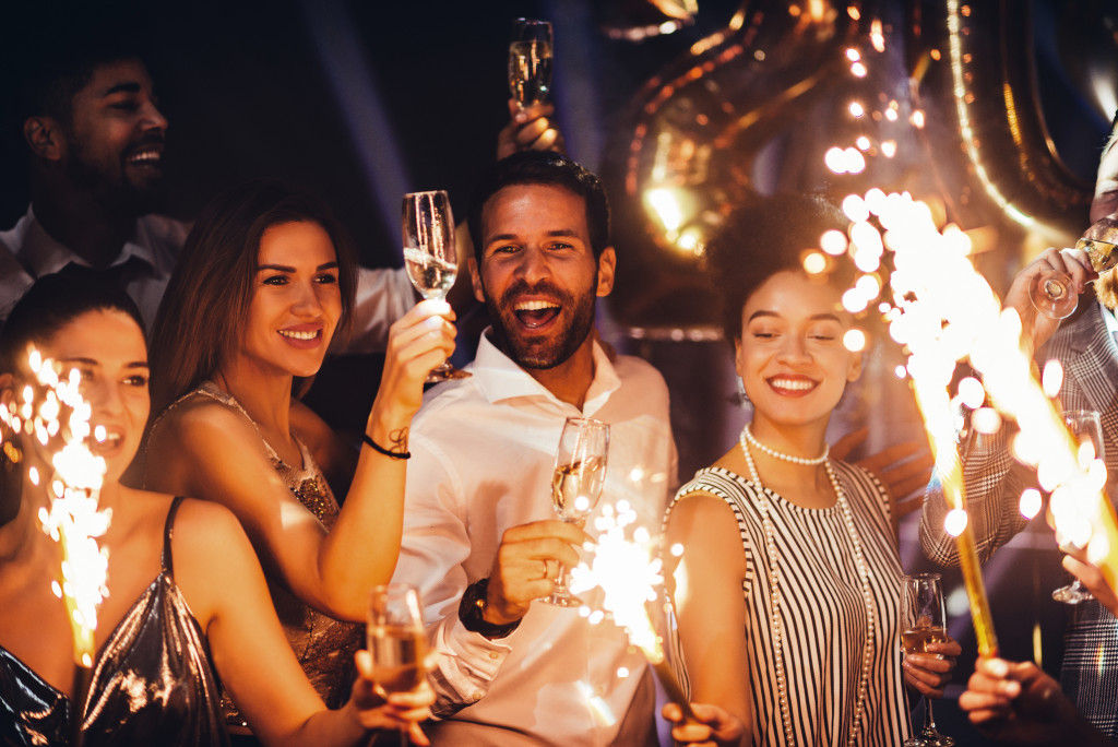 Group of people with champagne and sparklers