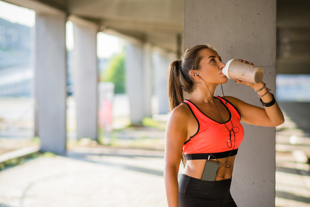 woman drinking protein shake