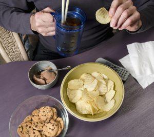 person binge eating