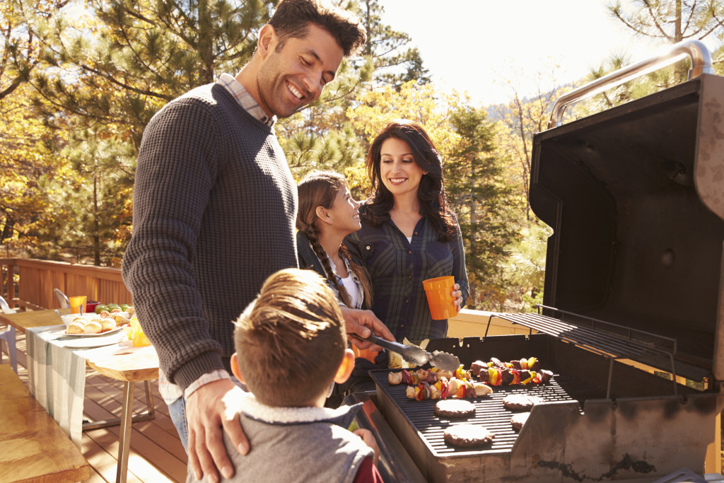 family cooking outside