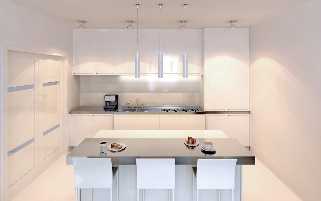 white kitchen and dining table in one picture