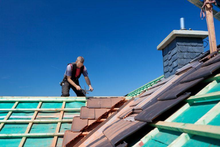 man doing someones roof