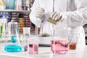 scientist mixing chemicals