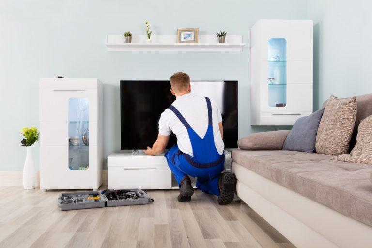 man repairing a TV
