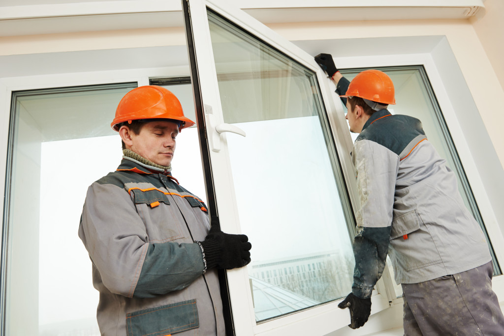 men installing a window